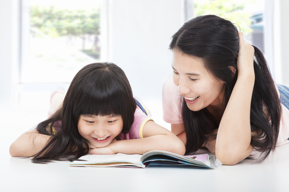 Mother helping child overcome maths anxiety